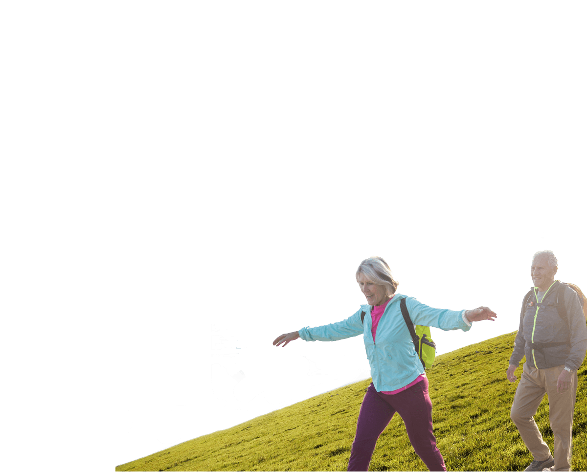 Image of a happy couple walking down a hill