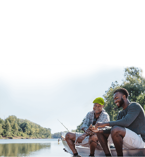 Image of two males fishing